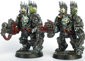 Sin Eater terminators armed with Heavy Flamer, combi-Bolter and Lightning Claws.