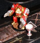 ...who reverentially carries it the length of the board and back to Space Marine controlled areas.