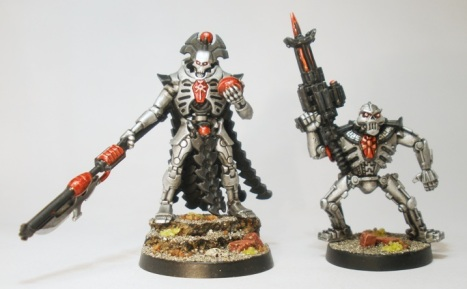 Lord Decimal rolls his optics at yet another report of botched plans by his second in command (an original metal GW Necron Warrior).