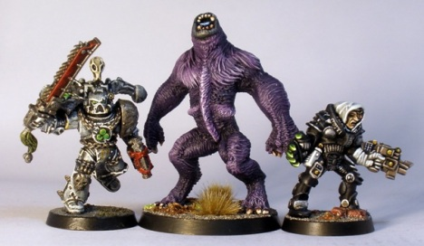 L to R: GW Chaos Space Marine, SotTR Urzine Were Bear, GW Inquisitor