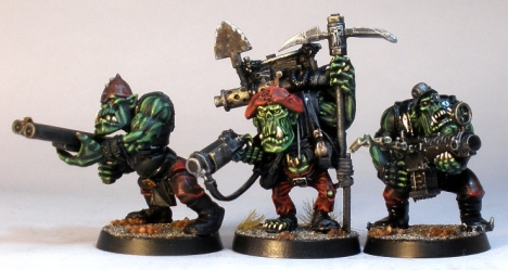 L to R: GW ork (with Ramshackle Games weapon), Nazgrub Wurrzag, GW ork (with Kromlech head).
