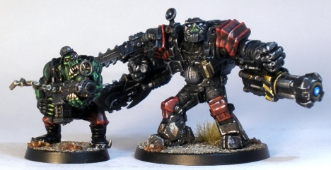 L to R: GW ork (with a Kromlech head), Deadzone Mauler Class Ripper Suit.