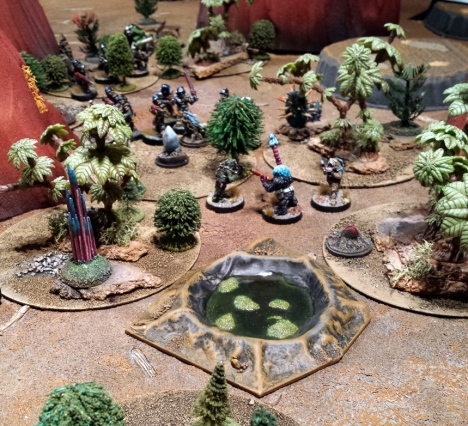 Aerial Kroot kindred and local icthyo-sapiens wait for their comrades to stumble through the undergrowth.  The jungle is indeed massive.