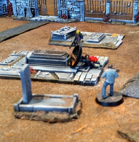 The fusillade of ork fire forces Agent Sophie to fall back from the zombies at the Southern energy source, although some canny maneuvering leads a zombies to blindly fall into an open grave and bach its brains out on a rock.