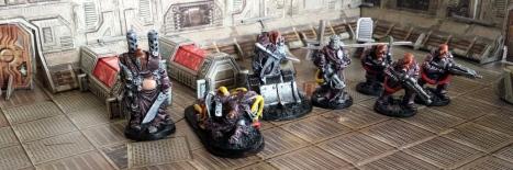 The Purgators.  L to R: Codename: Pig Iron, Codename: Cypher (officer), Codename: Bull, Codename Holy Smoke, 3 x Purgator trooper.