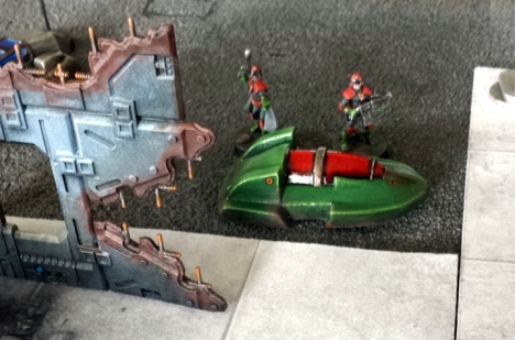 Sovs take cover behind an abandoned Foord hovercar.